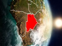 Botswana during sunrise. Highlighted in red on planet Earth with visible country borders. 3D illustration. Elements of this image furnished by NASA Stock Image