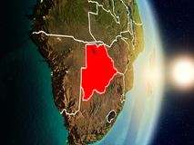 Botswana during sunrise. Highlighted in red on planet Earth with visible country borders. 3D illustration. Elements of this image furnished by NASA Royalty Free Stock Photo