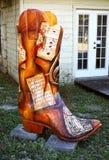 Botte de cowboy avec la musique de feuille Photographie stock libre de droits