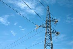 Botte de pylônes d'Elettric dans un ciel Images libres de droits