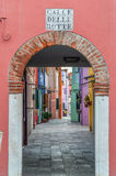Botte street on Burano island of Venice. Botte street (Calle delle Botte), filled with colored houses, is on Burano island of Venice, Italy Royalty Free Stock Photo