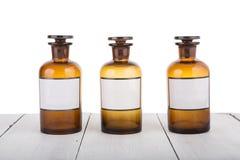Bottels da medicina alternativa com etiquetas vazias Foto de Stock