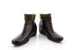 Bottes chaudes laineuses pelucheuses noires photos stock