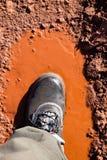 Bottes dans un magma boueux Photo stock