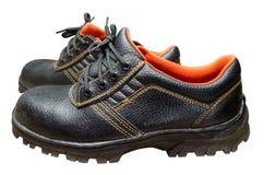 Bottes en acier noires de sécurité d'orteil sur le fond blanc Photos stock