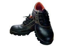 Bottes en acier noires de sécurité d'orteil sur le fond blanc Images stock