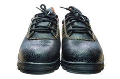 Bottes en acier noires de sécurité d'orteil sur le fond blanc Photographie stock libre de droits