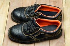 Bottes en acier noires de Toe Safety Images stock