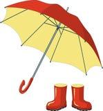 Bottes en caoutchouc rouges, parapluie Photo libre de droits