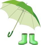 Bottes en caoutchouc vertes, parapluie Photo stock