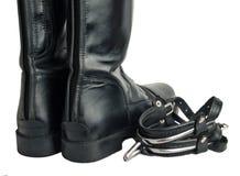 Bottes et dents d'équitation d'isolement sur le blanc Fin vers le haut Photos libres de droits