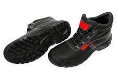 Bottes noires de sécurité avec le rouge - paire photos stock
