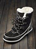 Bottes noires et blanches d'hiver Image stock