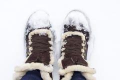 Bottes sur la neige Photographie stock