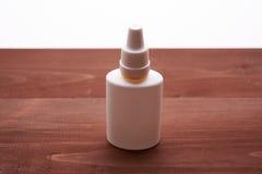Bottiglia bianca delle gocce nasali Immagine Stock Libera da Diritti