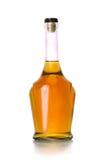 Bottiglia chiusa del cognac su fondo bianco Immagini Stock Libere da Diritti