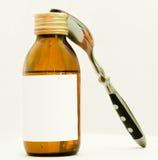 Bottiglia con il suspention ed il cucchiaino da tè Fotografia Stock