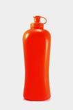 Bottiglia con la crema di abbronzatura isolata su bianco Fotografie Stock