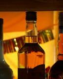 Bottiglia con la lampadina arancione Immagini Stock