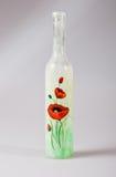 Bottiglia con la parte anteriore del mackintosh Immagini Stock Libere da Diritti