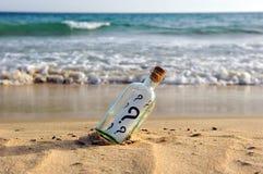 Bottiglia con le domande Immagini Stock