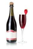 Bottiglia del champagne della fragola con vetro Fotografia Stock Libera da Diritti