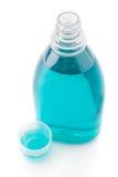 Bottiglia del colluttorio isolata su bianco Fotografia Stock