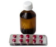 Bottiglia del ginseng e della bolla siberiani dell'estratto con le pillole Fotografia Stock Libera da Diritti