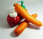 Bottiglia del pomodoro e della carota Immagini Stock Libere da Diritti
