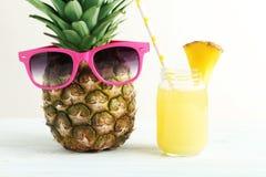 Bottiglia del succo di ananas Immagini Stock Libere da Diritti