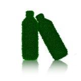 Bottiglia dell'erba verde con le ombre isolate Immagini Stock