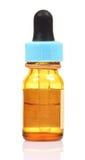 Bottiglia della medicina con il contagoccia Fotografie Stock Libere da Diritti