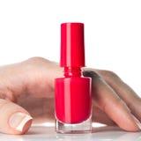 Bottiglia dello smalto per unghie rosso Fotografie Stock Libere da Diritti