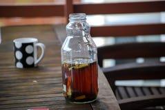 Bottiglia di acqua della sigaretta Fotografia Stock Libera da Diritti