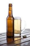 Bottiglia di birra e un vetro Fotografia Stock Libera da Diritti