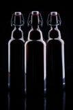 Bottiglia di birra sul nero Immagini Stock Libere da Diritti