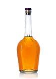 Bottiglia di brandy su fondo bianco Immagini Stock Libere da Diritti