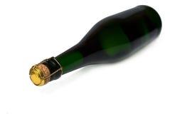 Bottiglia di champagne su una priorità bassa bianca Immagine Stock Libera da Diritti