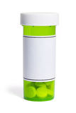 Bottiglia di pillola verde Fotografie Stock Libere da Diritti