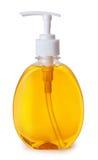 Bottiglia di plastica con sapone liquido su fondo bianco Fotografie Stock Libere da Diritti