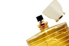 Bottiglia di profumo su fondo bianco Fotografia Stock