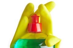 Bottiglia di sapone e dei guanti gialli Fotografia Stock