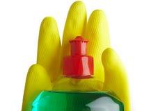 Bottiglia di sapone e dei guanti gialli Fotografia Stock Libera da Diritti