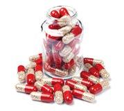 Bottiglia di vetro con le pillole della capsula Immagine Stock