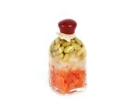 Bottiglia di vetro con le verdure fotografie stock libere da diritti