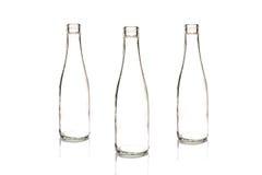 Bottiglia di vetro con un liquido bianco Fotografie Stock