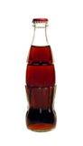Bottiglia di vetro della soda della cola isolata su un bianco Immagini Stock