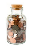 Bottiglia di vetro in pieno delle monete Fotografia Stock