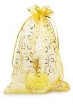 Bottiglia di vetro trasparente con profumo nella borsa della maglia Immagini Stock Libere da Diritti