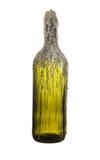 Bottiglia di vetro verde di vino con una candela isolata su backg bianco Fotografia Stock
